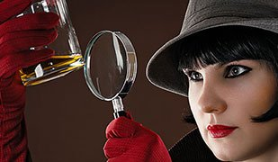 Woman detective with magnifying glass